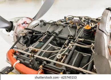 Aircraft engine detail. Piece of equipment of the aircraft engine closeup. View of an aircraft engine.