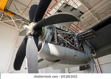 Aircraft engine maintenance. Airplane engine with propeller gets a repair. Military jet.