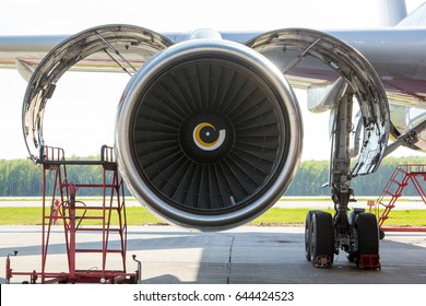 Aircraft engine maintenance and repair. Engine nacelle, air intake, fan blades and rotor close-up. Front View.