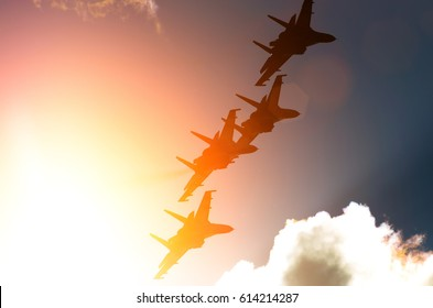Aircraft fighter jets against the background of sky and sun.