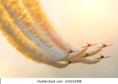 Aircraft fighter jets smoke the background of sky and sun.