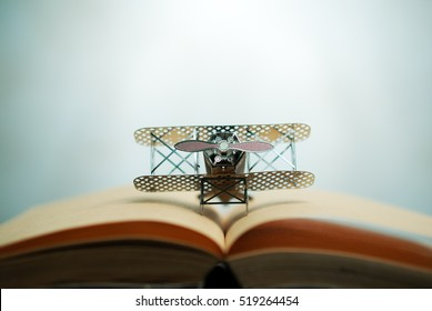aircraft fighter on open education book with abstract light , education planner concept.