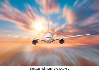 Aircraft flies motion effect high in the sky over the clouds dawn, traveling in the celestial expanse