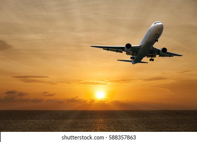 aircraft flying with scenic view of beautiful sunset and sea over the andaman