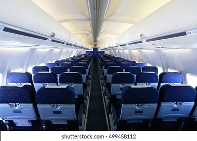 Aircraft interior with blue seats and white panel