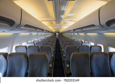 Aircraft interior. The passenger cabin of modern passenger airplane. Aisle between seats.