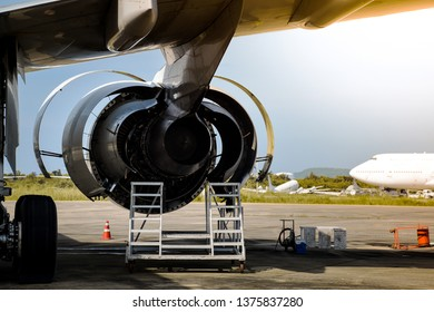 Aircraft jet engine during aircraft mechanic opened engine cowling for maintenance service and check before return to flight at aircraft hangar. Aircraft maintenance service check and repair.