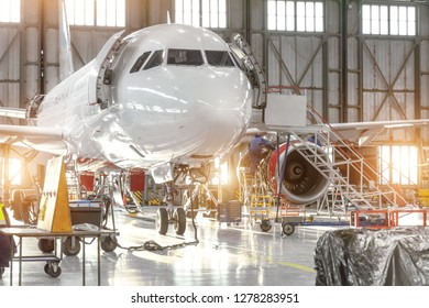 Aircraft jet on maintenance of engine and fuselage check repair in airport hangar