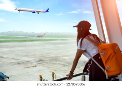 aircraft just in taxi run away in runway with disappointed and upset on missed the flight of woman traveler, passenger delay and lost of flight looking at the the flight goes away