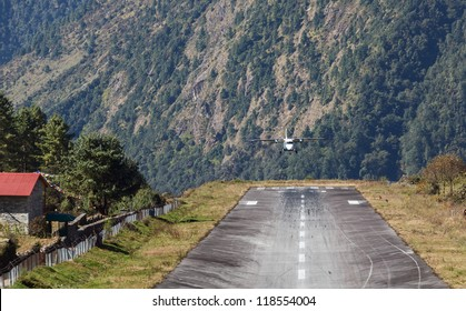 The aircraft is landing on the runway of the Tenzing-Hillary airport Lukla - Nepal, Himalayas