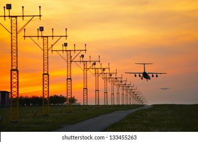 Aircraft is landing at the sunset - selective focus