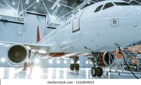 In Aircraft Maintenance Hangar Standing Clean Brand New Plane.