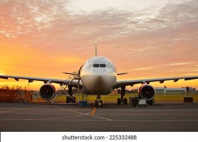 Aircraft maintenance  - large aircraft at the beautiful sunrise