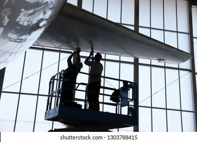 Aircraft mechanic, black and white, Repairing airplanes - Image