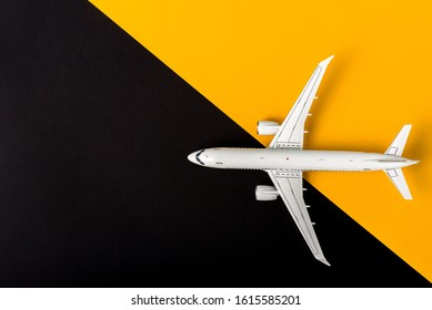 Aircraft model on yellow and black background, Top view with empty space. Concept of aircraft industry, airline safety, security
