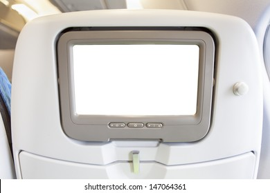 Aircraft monitor in passenger seat isolated on white background