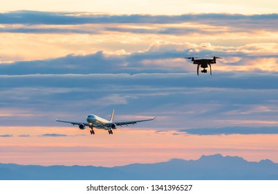 An aircraft on approach to an airport with a drone nearby.