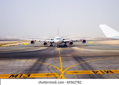 aircraft on landing strip in airport of Dubai