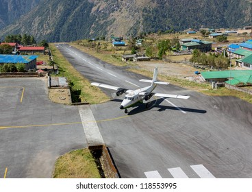The aircraft on the runway of the Tenzing-Hillary airport Lukla - Nepal