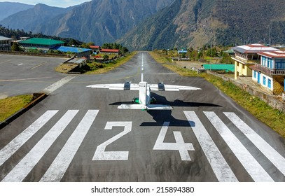 The aircraft on the runway of the Tenzing-Hillary airport Lukla - Nepal, Himalayas