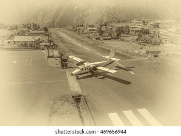 The aircraft on the runway of the Tenzing-Hillary airport Lukla - Nepal, Himalayas (stylized retro)