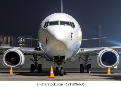 An aircraft parked at airport in the night.