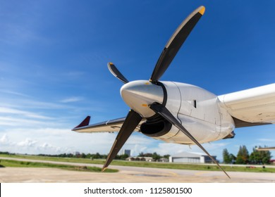 aircraft propeller blade and turboprop engines with airfield, blue sky background and copy space