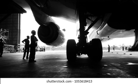 Aircraft push back into the  maintenance area.Aircraft(airplane)in aircraft hangar for maintenance service check by aircraft technician.Maintenance before flight.