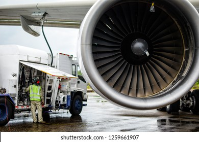Aircraft refueling by high pressure fuel supply truck.Passenger jet airplane refuel from supply truck, airport service, refuel,Aircraft Refueling Hose.