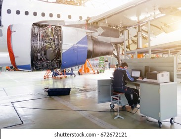 Aircraft service, view of the engine of the aircraft and with a technician at the computer