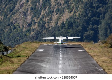 The aircraft takes off on the runway of the Tenzing-Hillary airport Lukla - Nepal, Himalayas