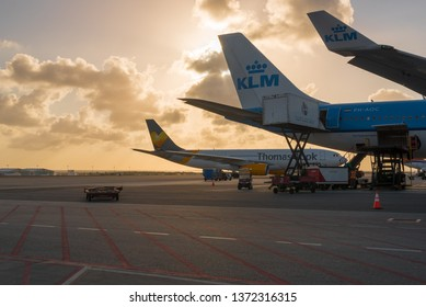 Aircraft from Thomas Cook Airlines and KLM airline in the landing area at Queen Beatrix International Airport. Oranjestad. Aruba. February 24, 2019.