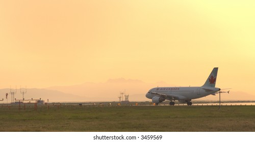 Aircraft waiting for takeoff at YVR international airport on a summer night