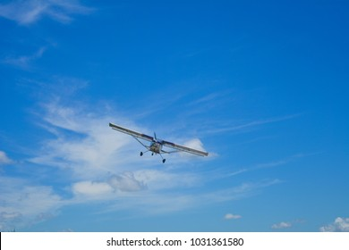 The aircraft is white with blue
