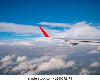 Aircraft wing flying on the sky.