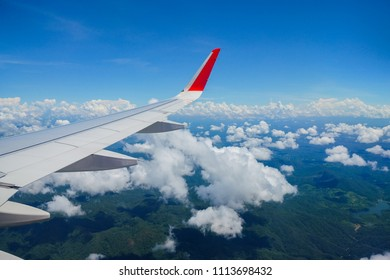 Aircraft wing on the blue sky with could background