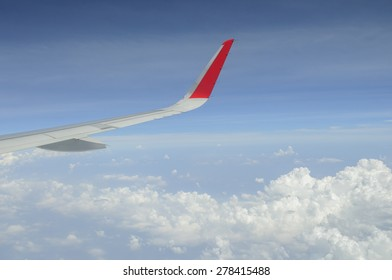 Aircraft wing on a blue sky.