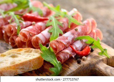 Air-dried Italian salami from Tuscany served on a wooden board with ciabatta bread