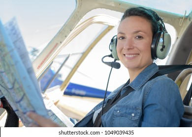 airforces female smiling helicopter pilot