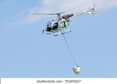AirGreen Aerospatiale AS318 Lama performing a firefighting mission display at Turin's centenary of aviation. 3rd July 2016