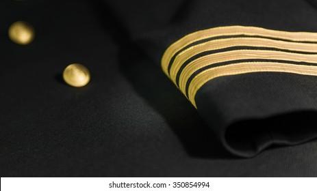 Airline Captain uniform jacket with four gold stripes.