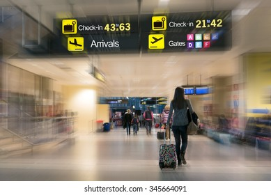 Airline Passengers inside an Airport.