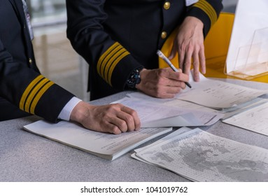 Airline pilot reading flight document before flight depart in briefing room