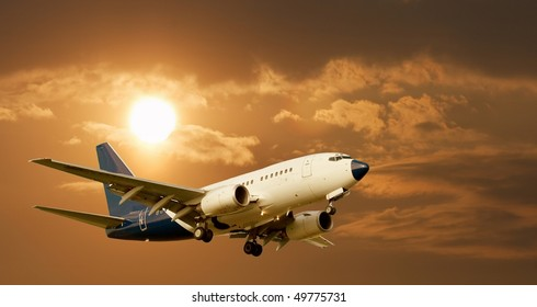 Airliner against glowing sky