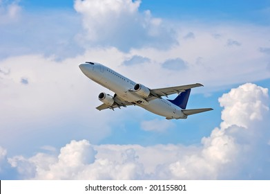 Airliner in the air on cloudscape background