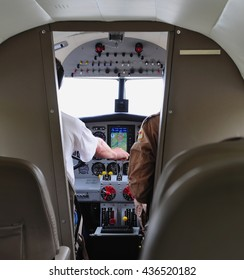 Airliner cockpit with two pilots