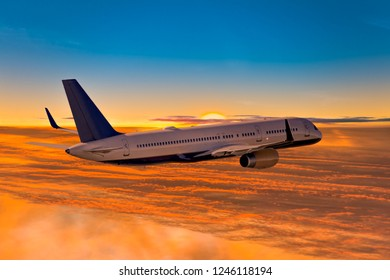 Airliner flies above the clouds in the sunset for vacation