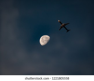 Airliner Flying Towards The Moon