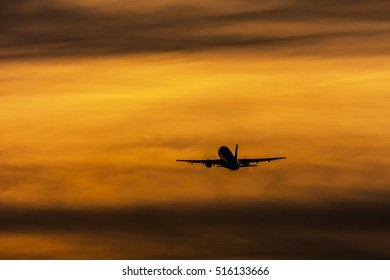 Airliner taking off at sunset