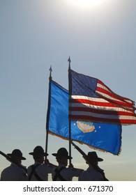 Airmen carrying backlit flag .